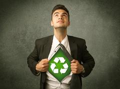 Enviromentalist business man tearing off shirt with recycle sign - stock photo