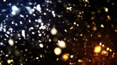 Square particles floating over black background. - stock footage