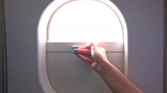 Closing plane window curtain close up Stock Footage