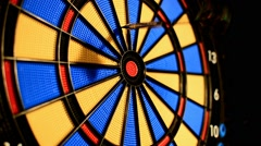 Stock Video Footage of dart game hitting a bullseye on third try attempt
