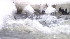 Reflections  in icicles and  water level. Stream in deep freeze. - stock footage