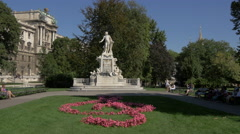 Mozart statue and flowers in the shape of a treble clef, Vienna Stock Footage