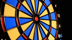 Placing darts onto dart board by hand cheating - stock footage