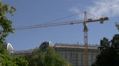 Yellow tower crane next to Burggarten, Vienna Stock Footage