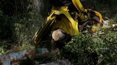 Harvester working in middle of a forest - stock footage