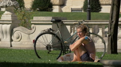 Stock Video Footage of Young woman relaxing in Burggarten, Vienna