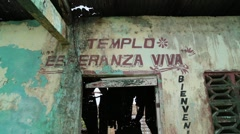 Front of Abandoned, Decaying Church with Spanish Written on Walls Stock Footage