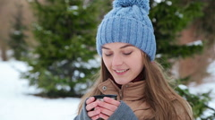 beautiful girl drinking from a thermos winter - stock footage