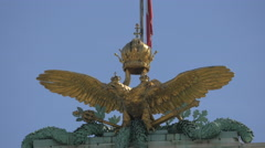 Close up view of the golden double-headed eagle on Neue Burg, Vienna Stock Footage