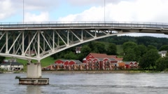 Cars pass by the bridge over the Sorfolda fjord in Straumen, Norway. Stock Footage