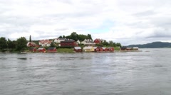 View to the village at the bank of the Sorfolda fjord in Straumen, Norway.64119 Stock Footage