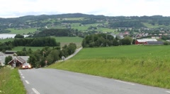 Cars pass by rural road in Straumen, Norway. Stock Footage