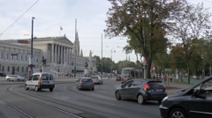 Traffic on Burgring, near the Austrian Parliament Building, Vienna Stock Footage