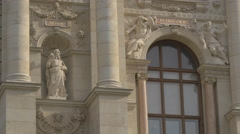 Statues, bas-reliefs and large windows at the Natural History Museum, Vienna Stock Footage