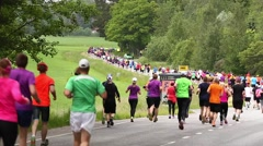 Marathon runners in a scenic enviroment Stock Footage