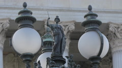 Vintage lamp post with statues at Austrian Parliament Building, Vienna - stock footage