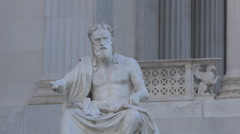 Man sculpture in front of the Austrian Parliament Building, Vienna Stock Footage
