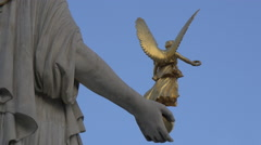 Statue of Athena at Austrian Parliament Building, on a sunny day in Vienna Stock Footage