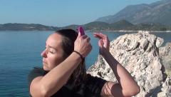 Woman combing her wet hair Stock Footage