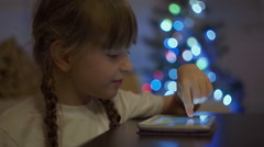 Little Girl Playing Games on Tablet Computer Stock Footage