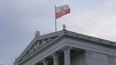 Waving flag on top of the Austrian Parliament Building, Vienna Stock Footage