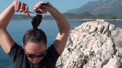 Woman cuts her hair 2 Stock Footage