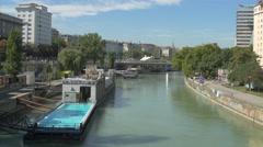 Donaukanal with Badeschiff seen from Aspernbruckebridge in Vienna Stock Footage