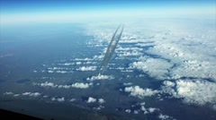 Airplain contrail going through the cloudness sky Stock Footage