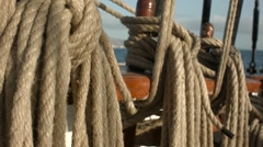 Close up view of ropes tidied up on a tall ship. - stock footage