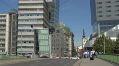 People walking and cars driving on Schwedenbrücke in Vienna Stock Footage