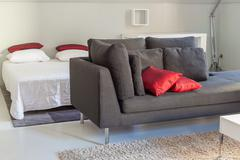 Modern apartments cozy furniture: a sofa with pillows - stock photo