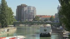 Donaukanal with Hotel Urania in Vienna Stock Footage