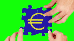 Hands solving an Euro symbol puzzle. 4 in 1. Green screen and wood background. - stock footage