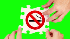 Hands solving a no smoking sign puzzle. 4 in 1. Green screen/wood background. Stock Footage