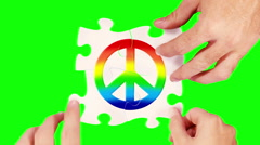 Hands solving a peace sign puzzle. 4 in 1. Green screen and wood background. Stock Footage