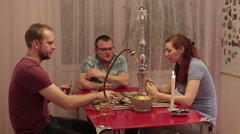 Among friends smokes hookah and talking Stock Footage