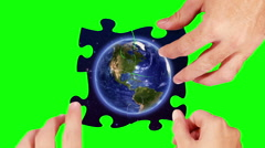 Hands solving an Earth and stars puzzle. 4 in 1. Green screen and wood. Stock Footage