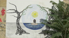 Painting with a tree and a woman in water in Vienna Stock Footage