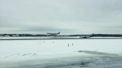 Airplane is landing in a slow motion in winter - stock footage