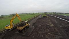 Beautiful aerial of hydraulic excavator loading a articulated dumper 4k - stock footage