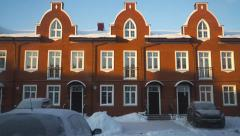 Morning shadow moving on red brick townhouses, time lapse. Establishing shot - stock footage