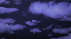 Flying through fluffy clouds at night. More options in my portfolio. Stock Footage