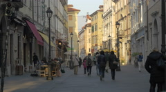 People walking on a street and eating at an outdoor restaurant in Trieste Stock Footage