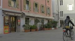 Woman biking near Lo Scrigno Di Bernes Walter in Piazza di Cavana in Trieste Stock Footage