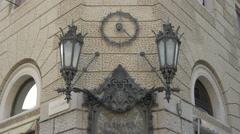 A clock and two lanterns on  Farmacia Serravallo in Piazza Cavana in Trieste Stock Footage
