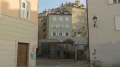 View of a parked bike near a building in Trieste Stock Footage
