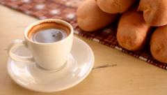 Cup of hot coffee and baguette Stock Footage