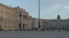 Stock Video Footage of View of people walking in and cars driving near  Piazza Unita in Trieste