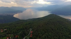 Aerial footage of mountains and lake maggiore at sunset Stock Footage