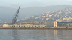 Pan view of the port and the coastal guard seen from Molo Audace in Trieste Stock Footage